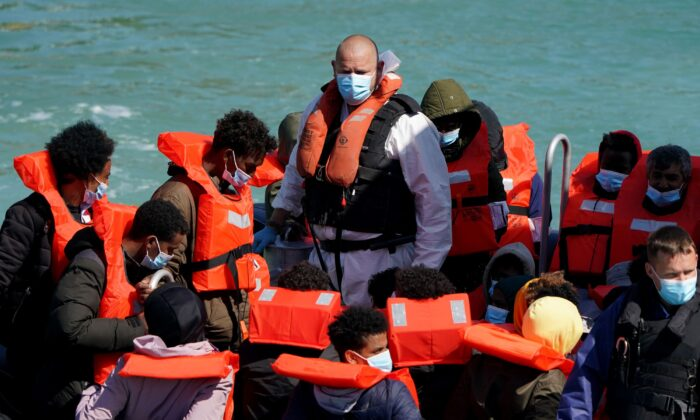 People thought to be migrants are brought into Dover, Kent, following a small boat incident in the Channel on July 1, 2021. (Gareth Fuller/PA)