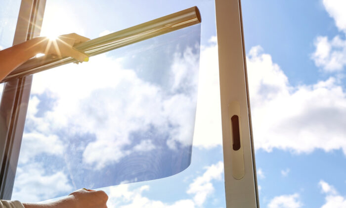 Window film is the perfect solution to reduce the amount of visible, infrared, and ultraviolet radiation while creating privacy. (Petr Smagin/Shutterstock)