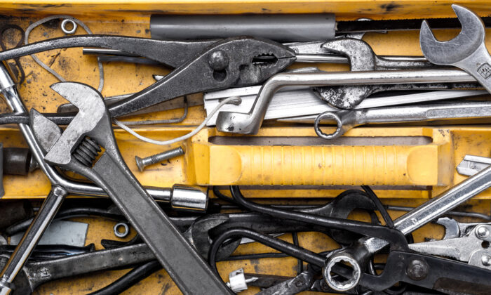 Take stock of your tool collection and consolidate so you don't have an overflowing toolbox. (NA image/Shutterstock)