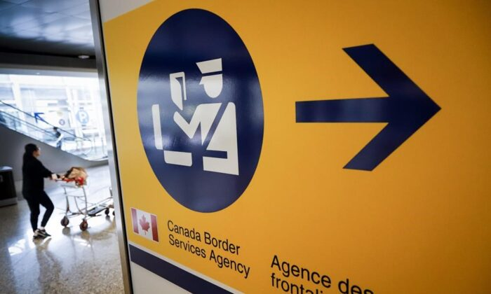 A Canada Border Services Agency (CBSA) sign is seen in Calgary, Alta., on Aug. 1, 2019. The agency that guards Canada's borders is putting would-be travellers on notice: if you're not eligible to enter the country now, you won't be on Monday. (The Canadian Press/Jeff Mcintosh)