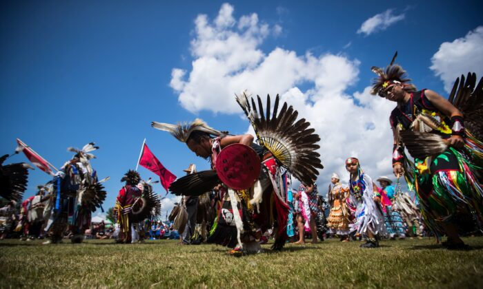 First Nations dancers participate in the grand entry on the final day of the 32nd annual Squamish Nation Youth Powwow, in West Vancouver on July 14, 2019. (The Canadian Press/Darryl Dyck)