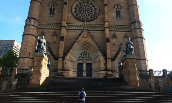 A man is seen praying outside St. Mary's Cathedral in Sydney, Australia, on Oct. 23, 2020. (Lisa Maree Williams/Getty Images)
