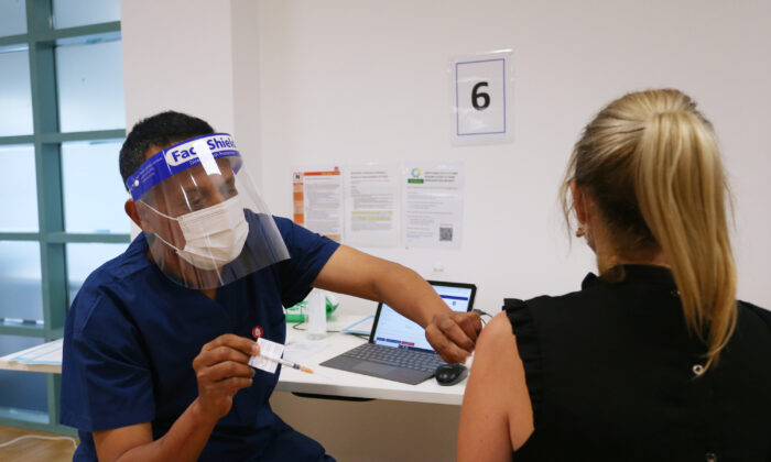 Registered Nurse, Mesfin Desalegn administers the Pfizer vaccine to a client at the St Vincent's Covid-19 Vaccination Clinic in Sydney, Australia on July 1, 2021 . (Lisa Maree Williams/Getty Images)