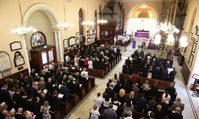 People gather for a special service of prayer and reflection at St. James Church in Sydney, Australia on December 19, 2014.  (Brendon Thorne/Getty Images)