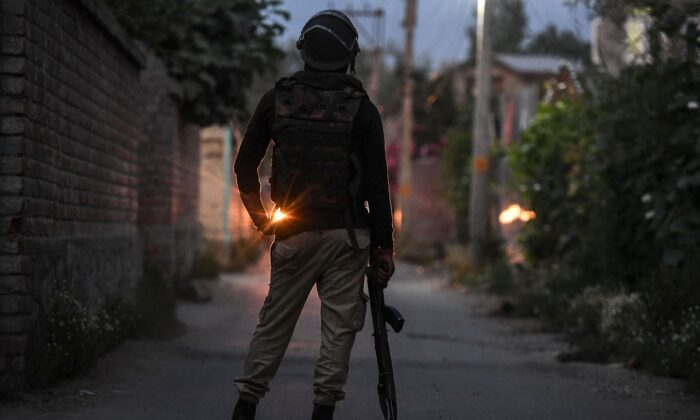 A soldier from the Indian government forces stands guard during a gun-battle started between suspected militants and Indian government forces at Malhoora on the outskirts of Srinagar on June 28, 2021. (Tauseef Mustafa/AFP via Getty Images)