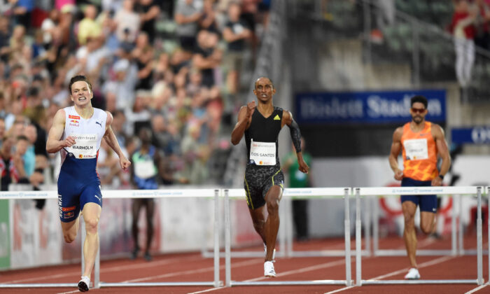 Norway's Karsten Warholm (L) and Brazil's Alison Dos Santos compete in the 400m hurdles men final at the Diamond League track and field meeting in Oslo, Norway, on July 1, 2021. (Annika Byrde/NTB/AFP via Getty Images)