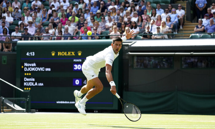 Serbia's Novak Djokovic plays a return to Denis Kudla of the United States during the men's singles third round match on day five of the Wimbledon Tennis Championships in London, on July 2, 2021. (Alberto Pezzali/AP Photo)
