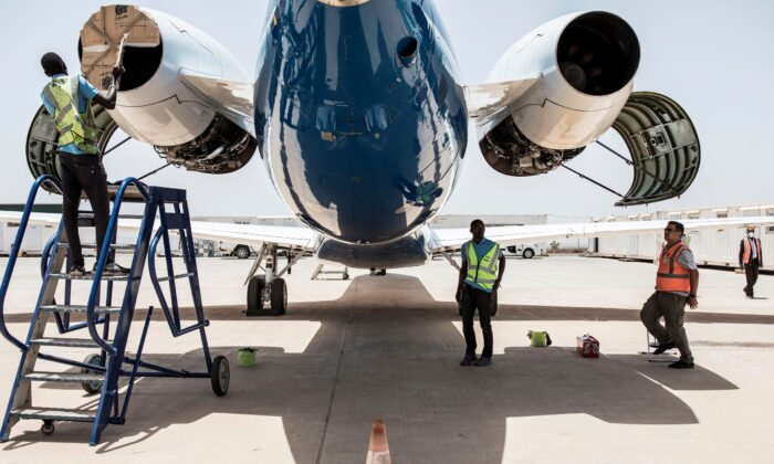 The Transair ground and engineering crew check and maintain their aircraft in Dakar on May 22, 2020. (John Wessels/AFP via Getty Images)