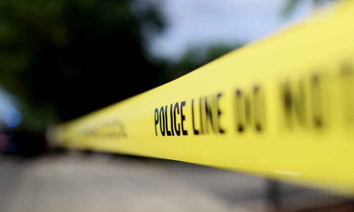 Police tape surrounds a crime scene where three people were shot at the Wentworth Gardens housing complex in the Bridgeport neighborhood in Chicago, Illinois, on June 23, 2021. (Scott Olson/Getty Images)