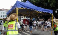 China's Virus Hotspot Lifts Lockdown But Sets Up Large Makeshift Quarantine Site