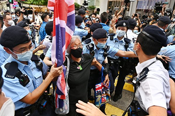 Activist Alexandra Wong (C), also known as Grandma Wong, is taken away by police while protesting on the 24th anniversary of Hong Kong's handover from Britain, in Hong Kong on July 1, 2021. (Song Bilong/The Epoch Times)