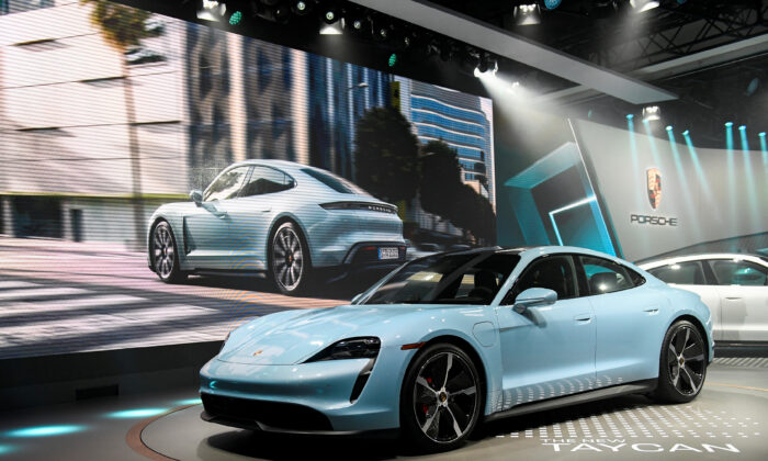 Porsche introduces its new Taycan 4S at the LA Auto Show in Los Angeles, Calif., on Nov. 20, 2019. (Andrew Cullen/Reuters)