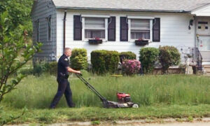 Rhode Island Police Officer Mows a 73-Year-Old Woman's Lawn After Noticing the Overgrown Yard