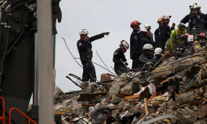 Rescue personnel continue the search and rescue operation for survivors at the site of a partially collapsed residential building in Surfside, near Miami Beach, Fla., on June 30, 2021. (Marco Bello/File Photo/Reuters)