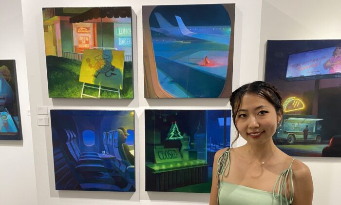 """Renae Wang, an MFA graduate at Laguna College of Art and Design, said her paintings are based in non-places, or public and transient spaces and feature an """"underlying solitude,"""" with characters in her paintings not interacting with each other.  (Jack Bradley/The Epoch Times)"""