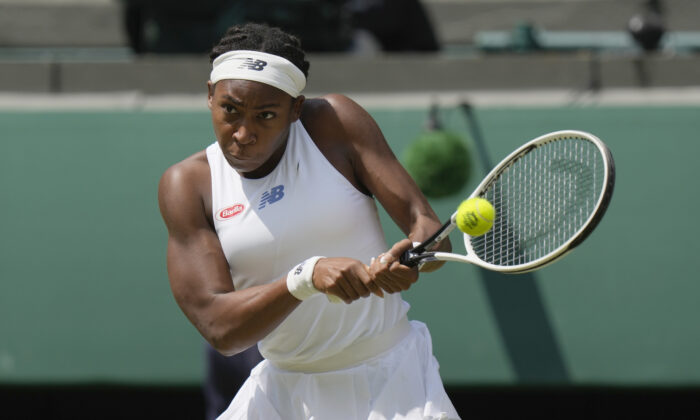 Coco Gauff of the United States plays a return to Slovenia's Kaja Juvan during the women's singles third-round match on day six of the Wimbledon Tennis Championships in London, on July 3, 2021. (Alastair Grant/AP Photo)