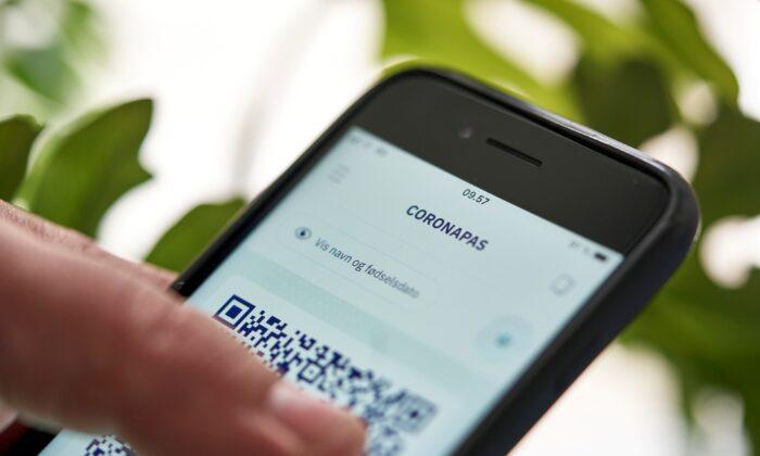 A new COVID-19 passport app is seen on a phone screen, in Copenhagen, Denmark, on May 28, 2021. (Signe Goldmann/Ritzau Scanpix/via Reuters)