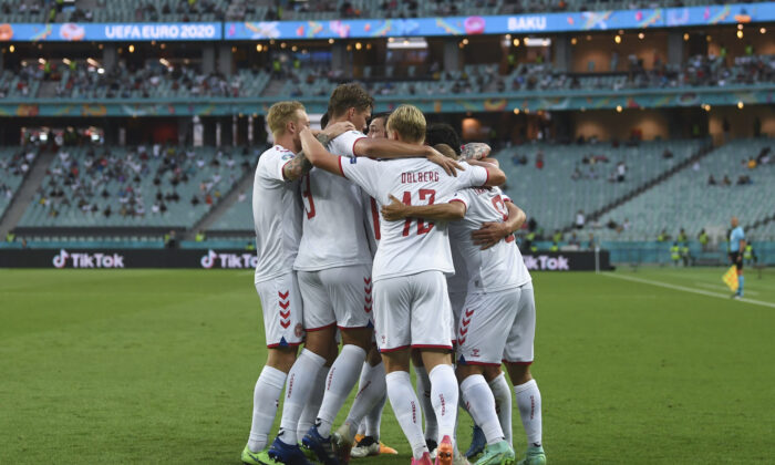 Denmark's Thomas Delaney celebrates with teammates after scoring his side's opening goal during the Euro 2020 soccer championship quarterfinal match between Czech Republic and Denmark, at the Olympic stadium in Baku, July 3, 2021. (Ozan Kose, Pool via AP)
