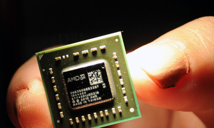 A chip the size of a coin, used in central processing units and a graphic processing units developed by the US-headquartered Advanced Micro Devices (AMD) is displayed during a press conference held in Taipei on May 24, 2011. (Sam Yeh/AFP via Getty Images)