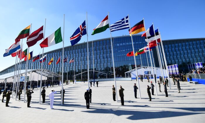Officials and military personnel at the NATO headquarters, in Brussels, on May 25, 2017. (Emmanuel Dunand/AFP via Getty Images)