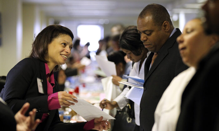 A job seeker meets with a recruiter during a job fair in Brooklyn, New York City, on April 12, 2021 (Justin Sullivan/Getty Images)