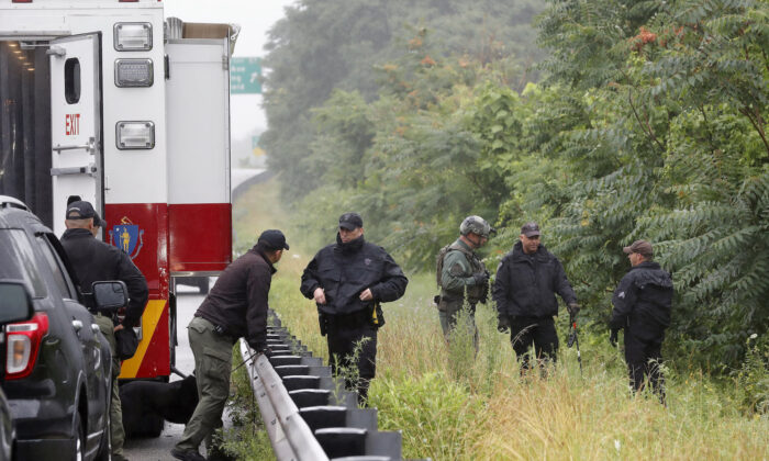 Police work in the area of an hours long standoff with a group of armed men that partially shut down I-95 on July 3, 2021, in Wakefield, Mass. (Michael Dwyer/AP Photo)