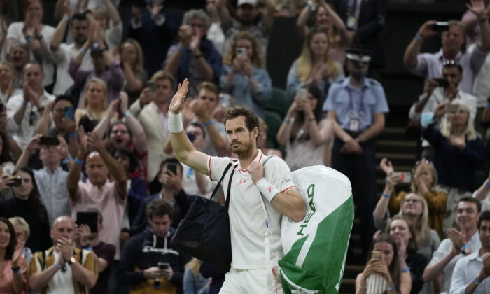 Britain's Andy Murray leaves Centre Court after being defeated by Canada's Denis Shapovalov in the men's singles third round match on day five of the Wimbledon Tennis Championships in London, on July 2, 2021. (Kirsty Wigglesworth/AP Photo)