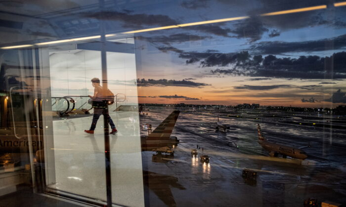 A passenger arrives at terminal D of Miami International Airport after heavy rains, as Hurricane Elsa moves towards south Florida, in Miami, U.S. July 2, 2021. (Carlos Barria/Reuters)