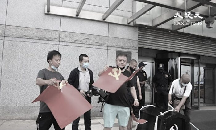 Scores of exiled Tibetans, Hong Kongers, Chinese dissidents, and others burn down the flags of the Chinese Communist Party (CCP) and present a black coffin for the CCP in protest of its brutal rule in China in front of China's consulate general in New York City, on July 1, 2021, its 100th anniversary. (Huang Xiaotang/The Epoch Times)