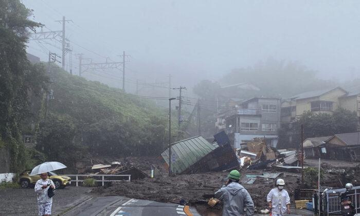 A road is covered by mud and debris following heavy rain in Atami city, Shizuoka prefecture, on July 3, 2021. (Satoru Watanabe via AP)