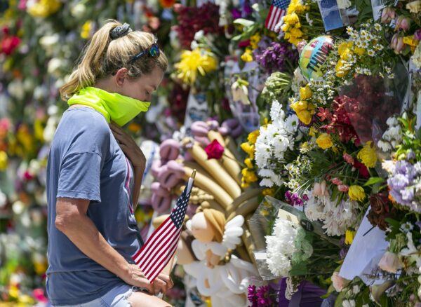 Miami Beach resident Tracey Lynne visits a makeshift memorial