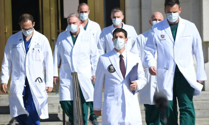 A group of male doctors at Walter Reed Medical Center in Bethesda, Maryland, on Oct. 5, 2020. (Saul Loeb/AFP via Getty Images)