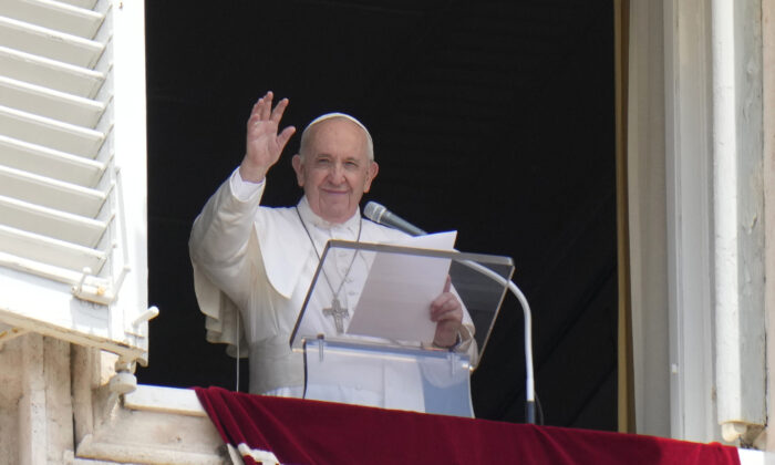 Pope Francis waves to the crowd from the window of his studio overlooking St. Peter's Square at the Vatican on July 4, 2021  (Alessandra Tarantino/AP Photo)