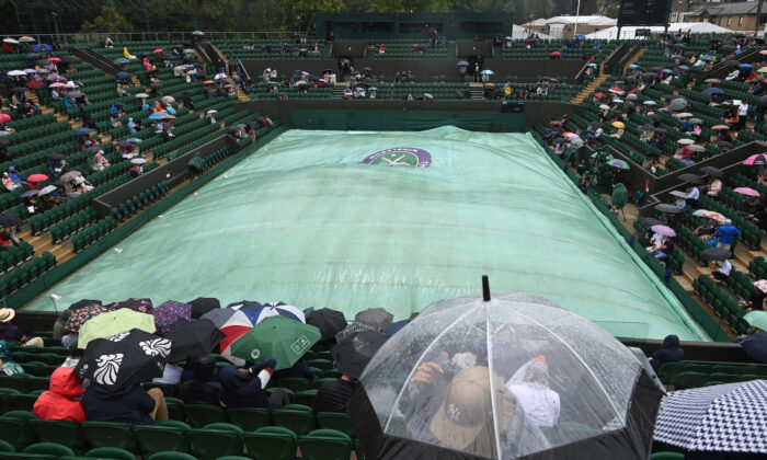 General view of court covered as rain delays play at The Wimbledon Championships at the All England Lawn Tennis and Croquet Club, in London, Britain, on July 3, 2021. (Toby Melville/Reuters)