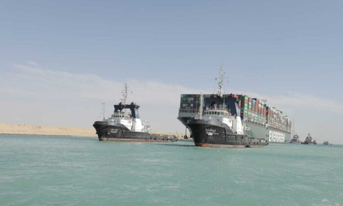 Released by Suez Canal Authority, the Ever Given, a Panama-flagged cargo ship is accompanied by Suez Canal tugboats as it moves in the Suez Canal, Egypt, on March 29, 2021. (Suez Canal Authority via AP)