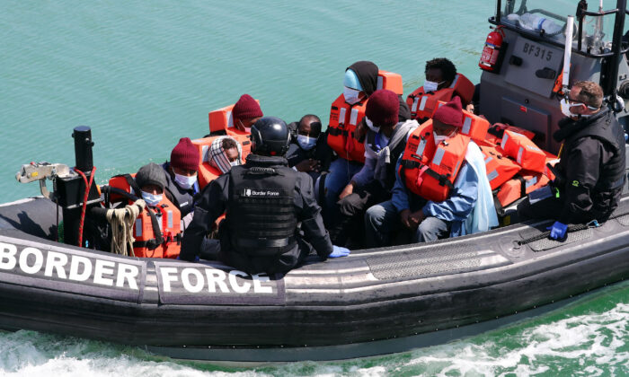 A group of people thought to be illegal migrants are brought in to Dover, Kent, following a small boat incident in the Channel on June 6, 2021. (Gareth Fuller/PA)