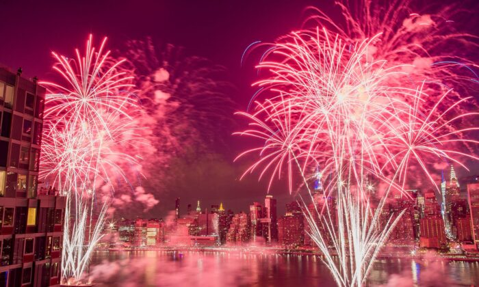 With the New York City skyline in the background fireworks explode during an Independence Day show over the East River in New York, on July 4, 2017. (Andres Kudacki/File/AP Photo)