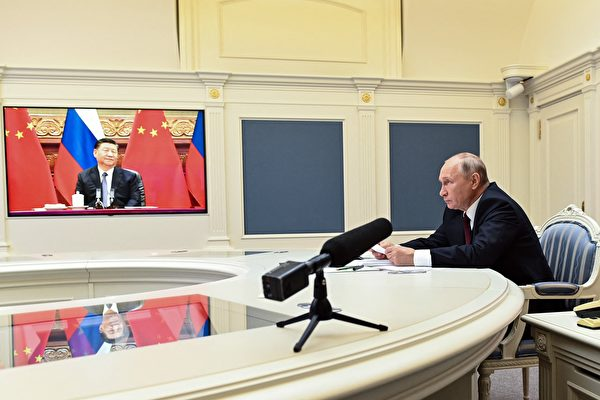 Russian President Vladimir Putin holds a meeting via video conference with Chinese President Xi Jinping at the Kremlin in Moscow on June 28, 2021. (Photo by Alexey Nikolsky / Sputnik / AFP)