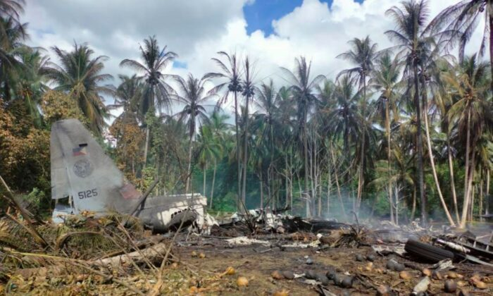 The remains of a Philippine military C-130 plane that crashed in Patikul town, Sulu province, southern Philippines, on July 4, 2021. (Joint Task Force-Sulu via AP)