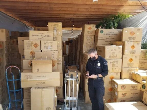 police-shows-boxes-of-fireworks-explosives