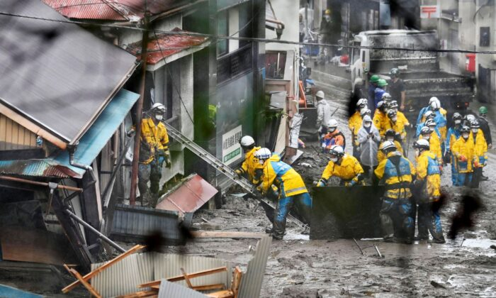 Rescuers conduct a search operation inside a building at the site of a mudslide at Izusan in Atami, Shizuoka prefecture, southwest of Tokyo, Japan, on July 4, 2021. (Kyodo News via AP)