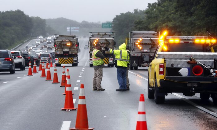 Traffic on Interstate 95 is diverted in the area of an hours long standoff with a group of armed men that partially shut down the highway, in Wakefield, Mass., on July 3, 2021. (Michael Dwyer/AP Photo)