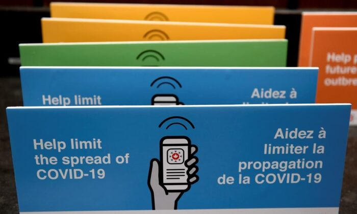 Podium placards promoting the COVID Alert app are seen on a table on Parliament Hill in Ottawa, on July 31, 2020. (The Canadian Press/Justin Tang)