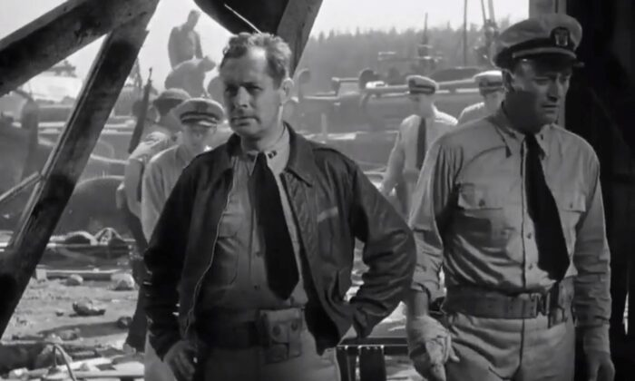 """The two main actors in the movie are Robert Montgomery (L) and John Wayne in """"They Were Expendable."""" (Metro-Goldwyn-Mayer)"""