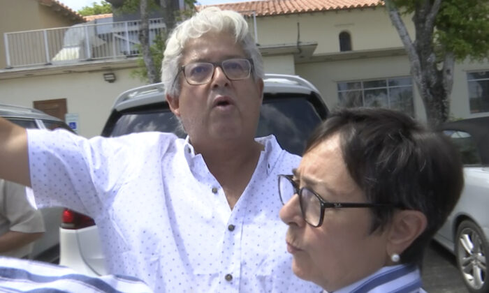 Alfredo Lopez talks about how his family escaped from the Champlain Towers South condo building in Surfside, Fla., on June 27, 2021. (Stacey Plaisance/AP Photo)