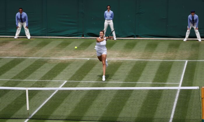 Belarus' Aryna Sabalenka is in action during her fourth round match against Kazakhstan's Elena Rybakina at All England Lawn Tennis and Croquet Club, London, on July 5, 2021. (Peter Nicholls/Reuters)