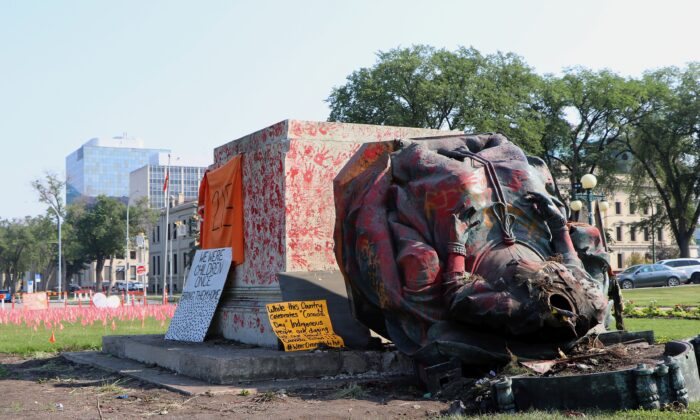 A vandalized statue of Queen Victoria lies on the ground at the provincial legislature in Winnipeg on July 2, 2021. The statue and one of Queen Elizabeth II were toppled on Canada Day during demonstrations concerning indigenous children who died at residential schools. (The Canadian Press/Kelly Geraldine Malone)