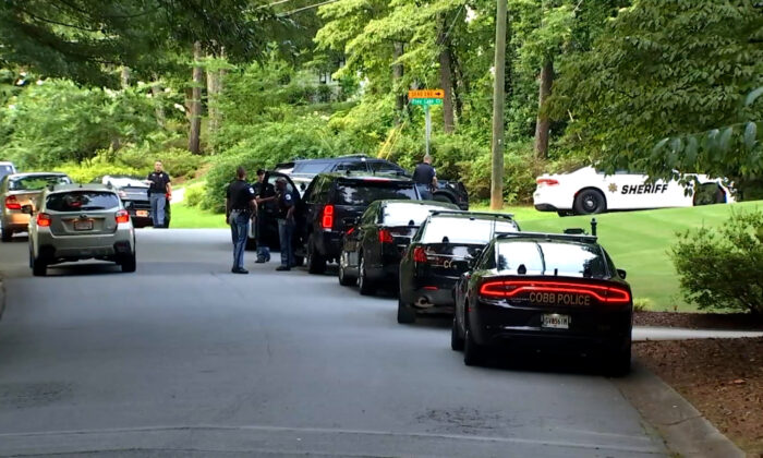 Cobb County police converge on the Pinetree Country Club in Kennesaw, Ga., on July 3, 2021, after the club pro's body was found on the course. (Courtesy of WGCL)