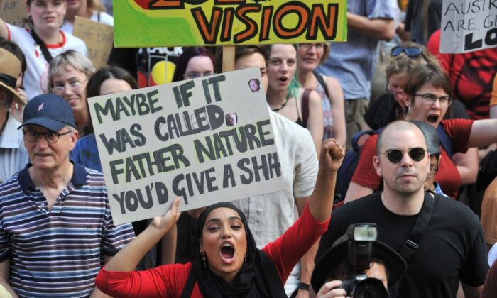 Participants hold placards as they take part in a demonstration demanding the government take immediate action against climate change in Sydney, Australia, on Jan. 10, 2020. (Mohammed Farooq/AFP via Getty Images)