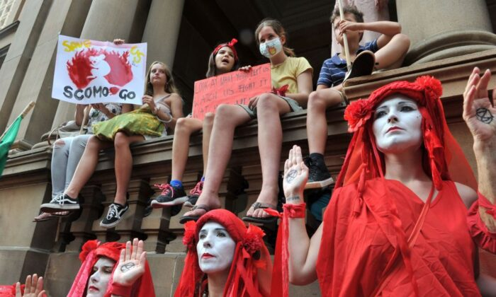 Participants take part in a demonstration demanding the government take immediate action against climate change in Sydney, Australia on January 10, 2020. (Mohammad Farooq/AFP via Getty Images)